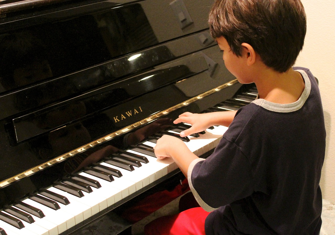 Child playing on donated piano