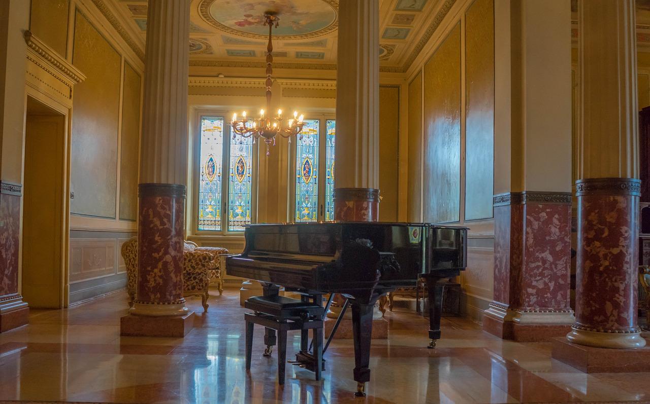 Piano caster cups under a grand piano