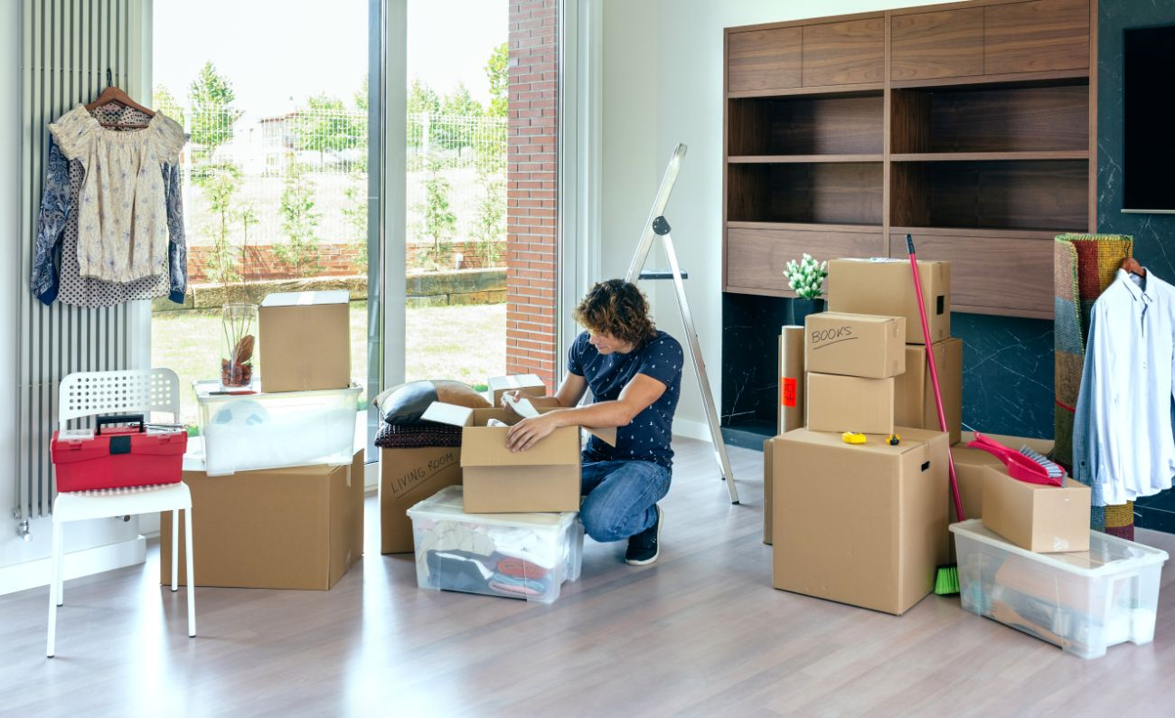 Person organizing moving boxes