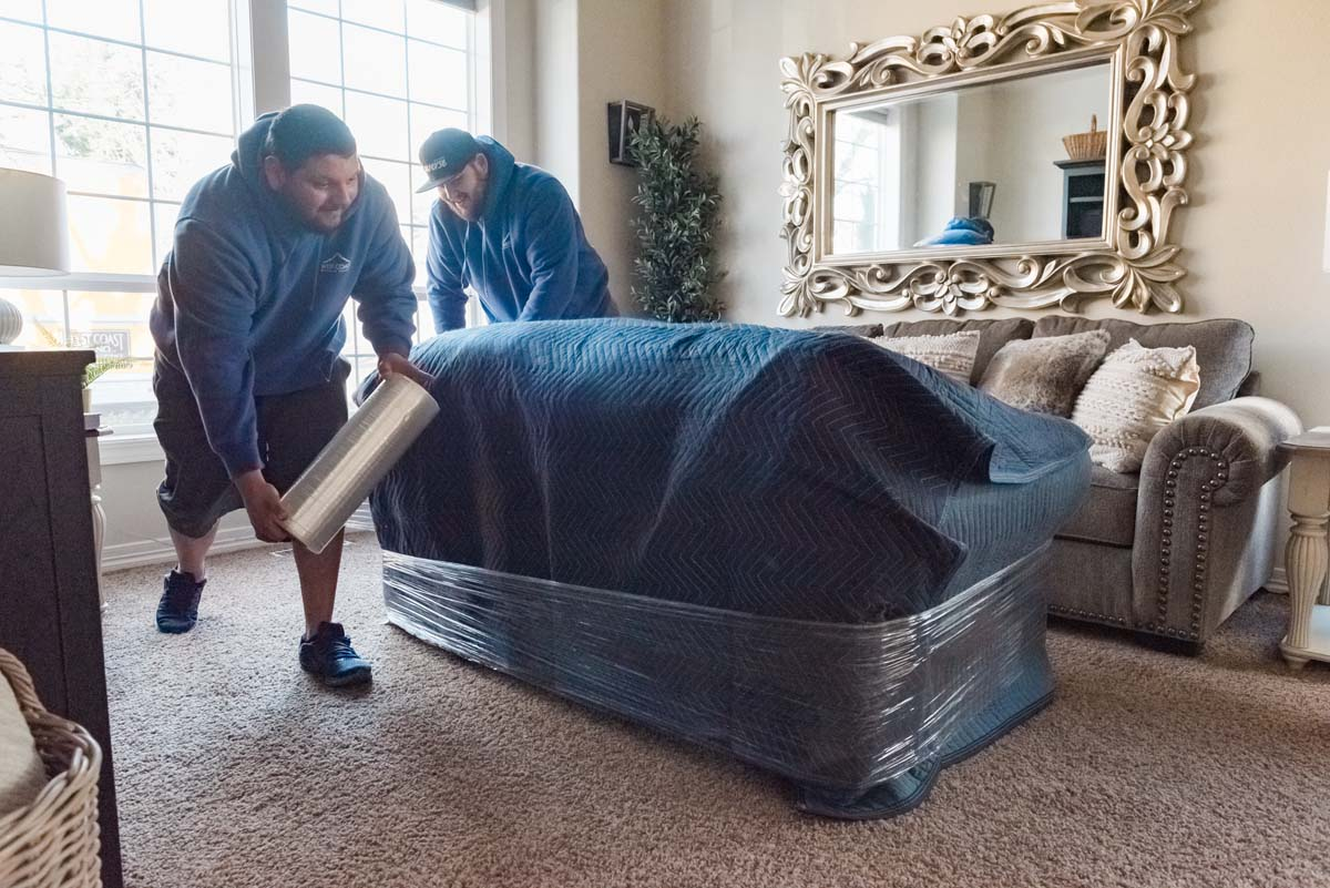 West Coast Moving team wrapping furniture for moving
