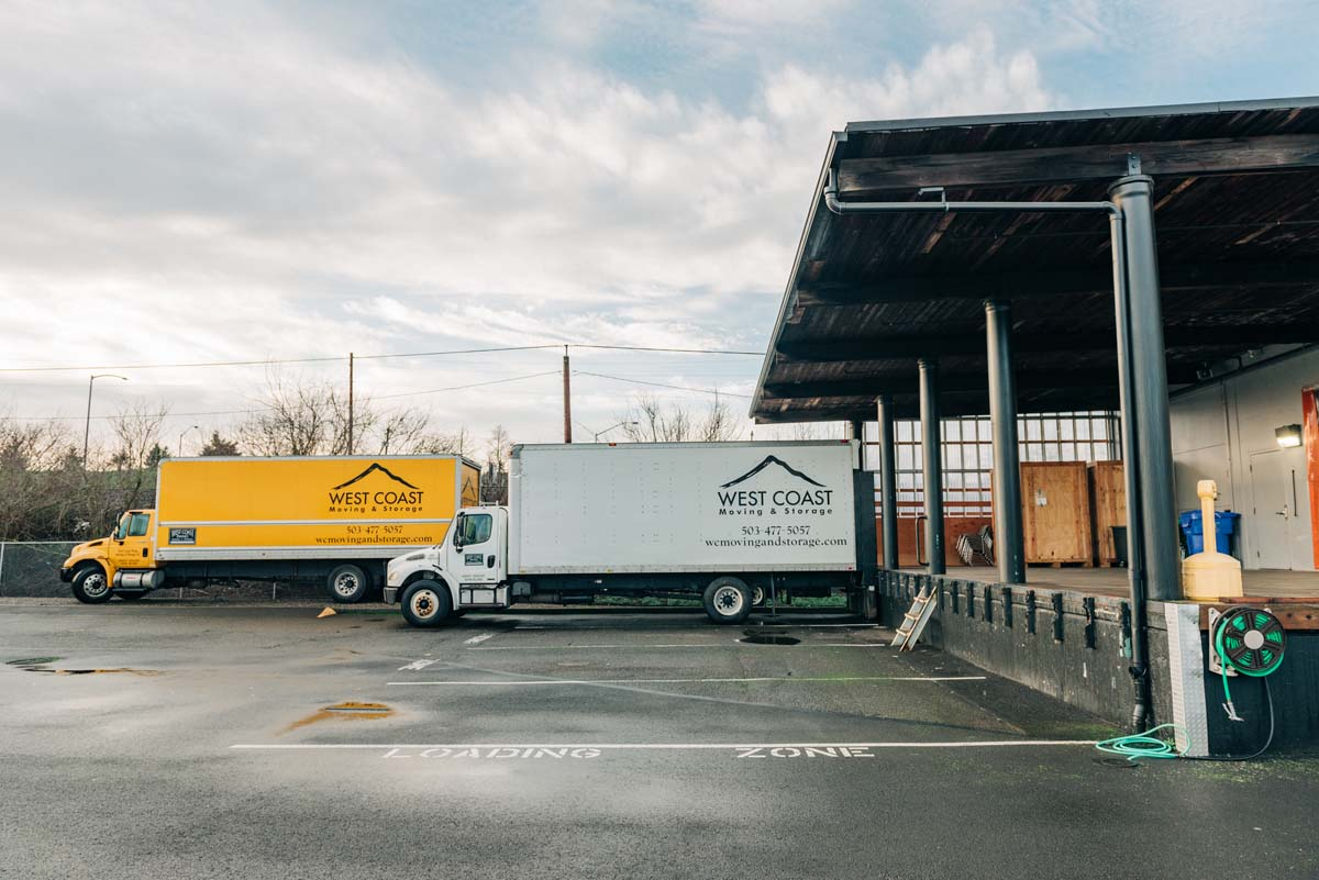 West Coast Moving & Storage trucks at Portland facility