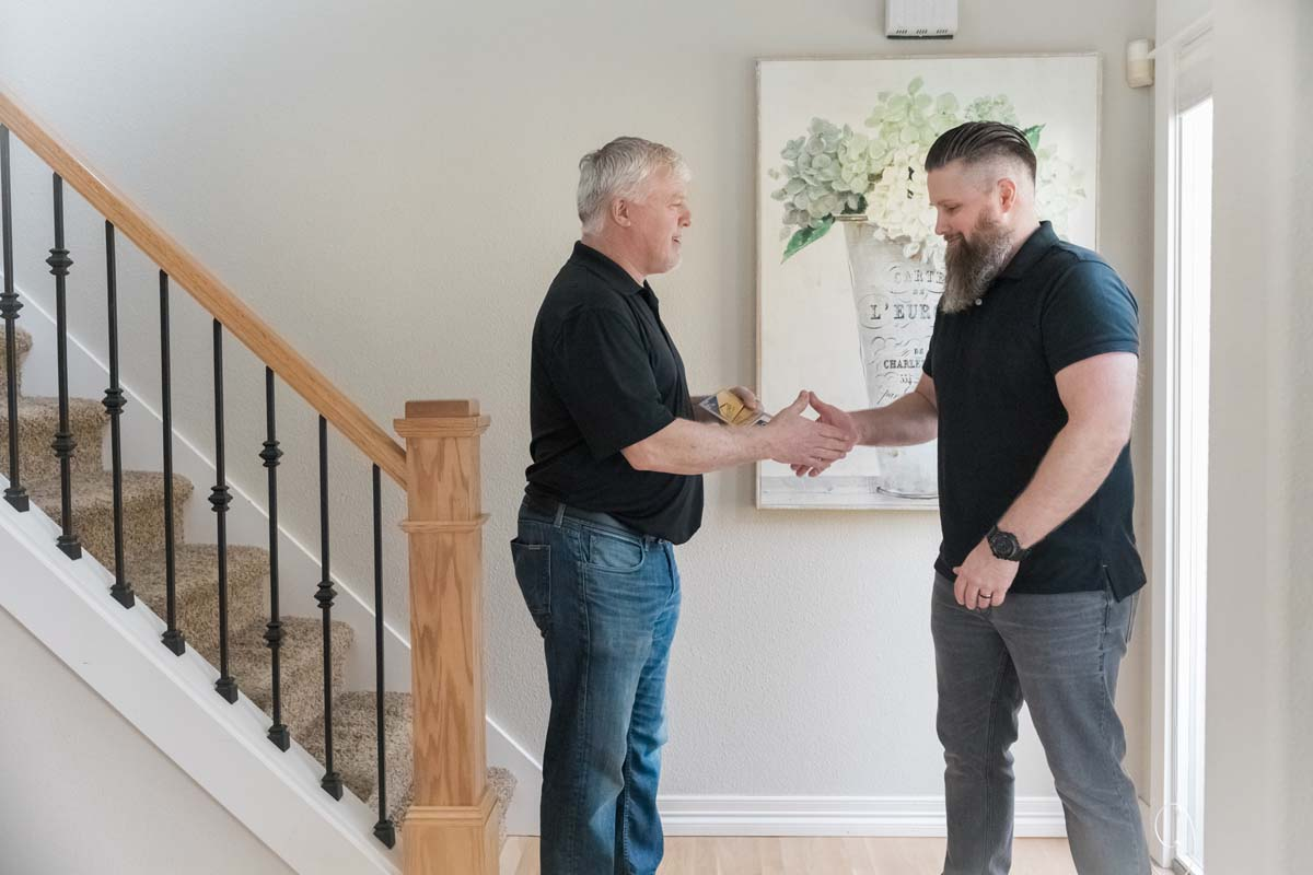 Mover and homeowner shaking hands