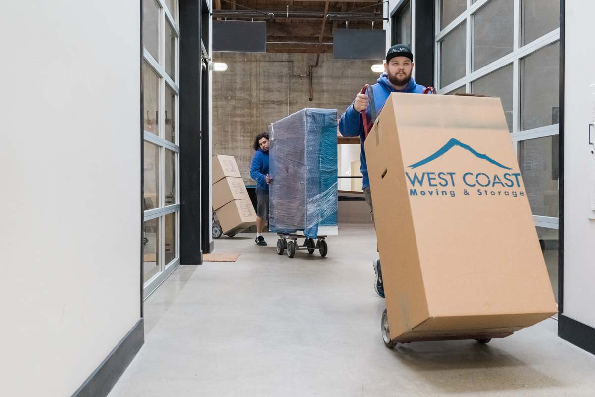 Movers transporting boxes to commercial storage facility in Portland