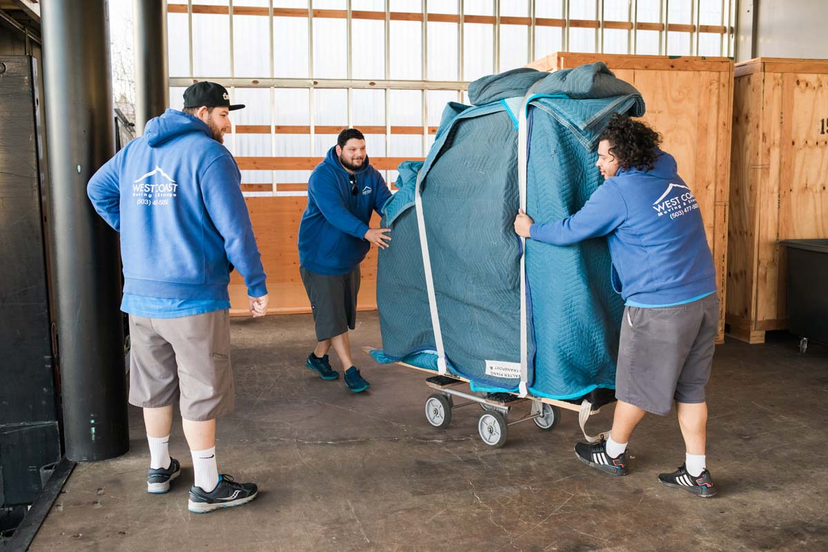 West Coast moving team loading piano