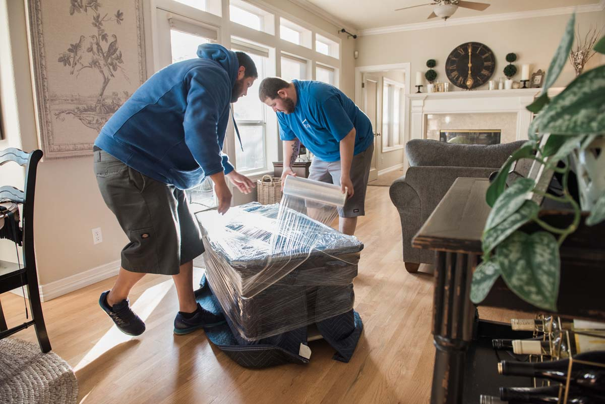 West Coast mover wrapping and padding furniture for moving