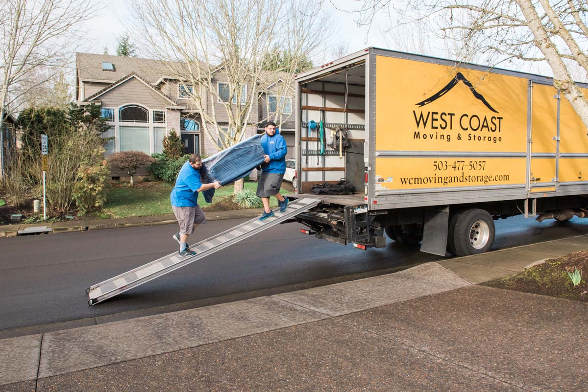Long distance movers loading moving truck