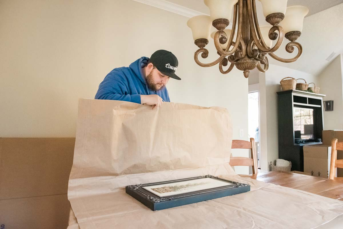 Specialty mover carefully wrapping art