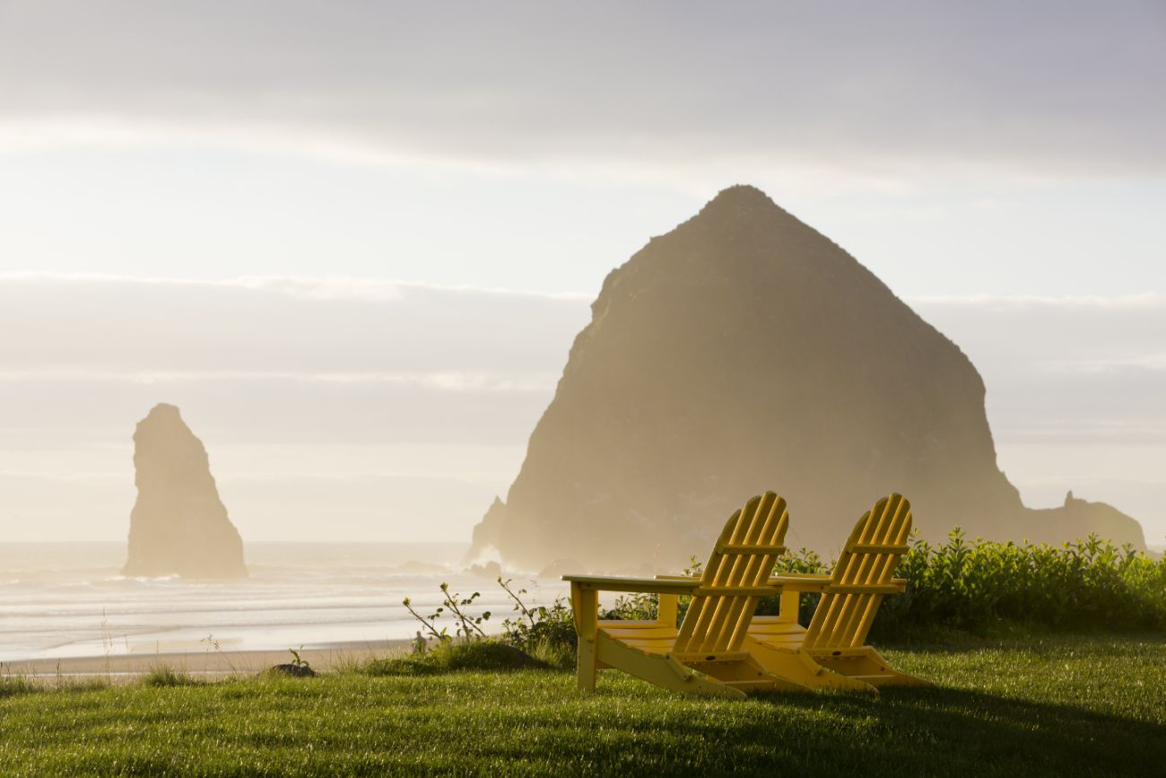 Oregon Coast view of Haystack Rock from adirondack chairs outside beach home